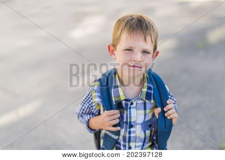 A pre-school student going to school on the playground