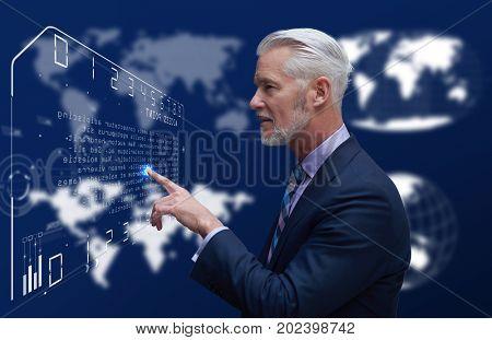 Portrait of senior businessman in futuristic room