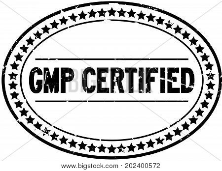 Grunge black GMP certified oval rubber seal stamp on white background
