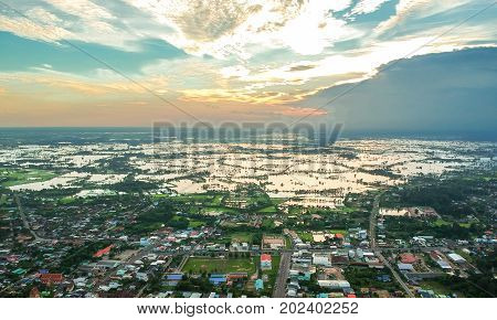 Aerial photo of small town and flood Kasetwisai town Roiet city Thailand