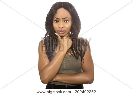 Black female isolated on a white background displaying failure facial expressions. She is young and of African American ethnicity.