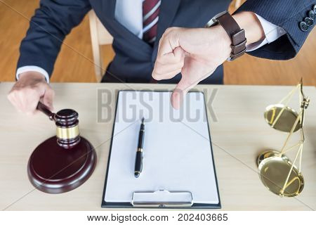 Law Court Or Justice Concept. Portrait Lawyer Making Thumb Down Hand