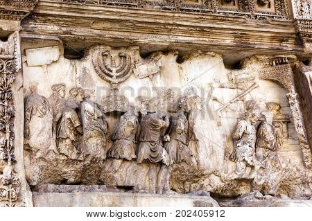Titus Arch Roman Loot Menorah Temple Jerusalem Forum Rome Italy. Stone arch was erected in 81 AD in honor of Emperor Vespasian and his son Titus for conqueiring Jerusalem and destroying the Jewish temple in 70 AD.