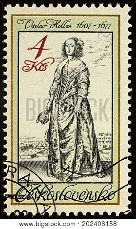Moscow Russia - September 01 2017: A stamp printed in Czechoslovakia shows Lady with flower engraving by Vaclav Hollar (1607-1677) series