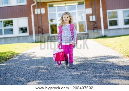 A pre-school student going to school with smile