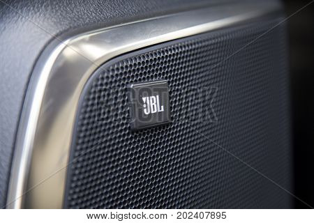Hanoi, Vietnam - Sep 1, 2017: Close up of the logo of JBL on the door of a car front, taken within a test drive. JBL is an American audio electronics company founded in 1946 by James Bullough Lansing