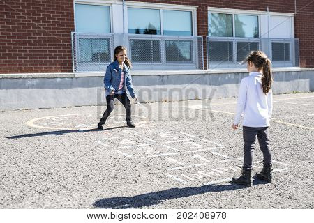 A Hopscotch on the schoolyard with friends play together