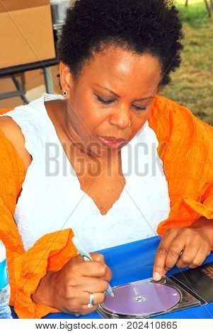 AUGUST 5, 2011, NEWPORT RI. CIRCA: Jazz violinist Regina Carter signing her new cd at the Newport Jazz Festival.
