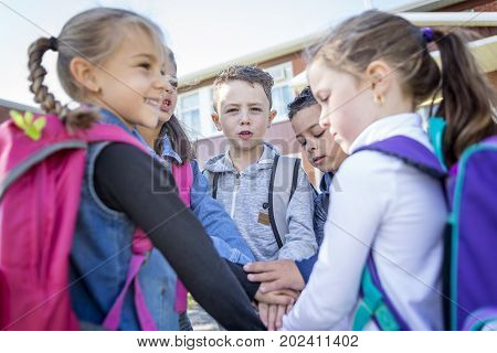 A Group of students outside at school standing together