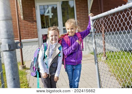two childs girls at elementary school outside
