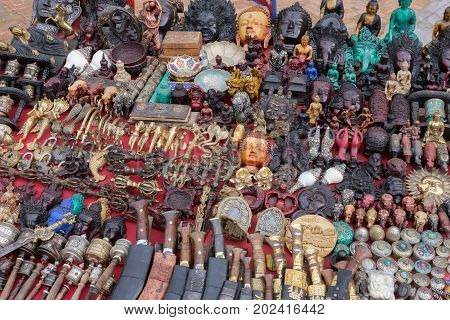 Statuettes knives and handicrafts on sale in the Thamel District Durbar Square Kathmandu Nepal