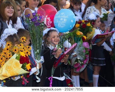 Adygea Russia - September 1 2017: happy children enrolled in the first class with gifts in the hands of teachers and high school students on the school line in the day of knowledge