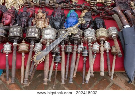 Sword prayer drums vadjras statuettes and handicrafts on sale at marketplace Kathmandu Nepal