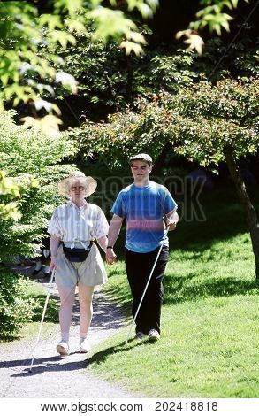 JANUARY 16, 2006. SEATTLE, WA. CIRCA: Blind couple walking through a public park on their first blind date.