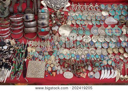 Jewelry amulets souvenirs and handicrafts for sale on marketplace Kathmandu Nepal