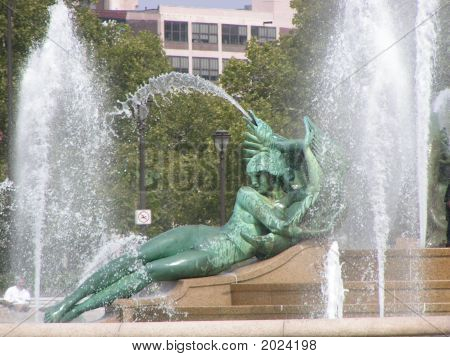 Swan Fountain with a young girl leaning on her side against an agitated water-spouting swan representing the Wissahickon Creek poster