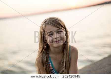 A Portrait of a girl in sunset sky