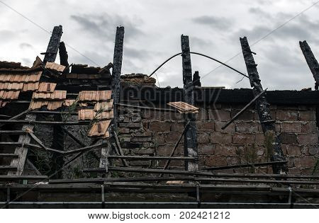 Burnt house roof with some tiles remains on it