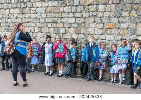 WINDSOR ENGLAND - JUNE 09 2017: Pupils of a primary school having an excursion to Windsor Castle country house queen of England
