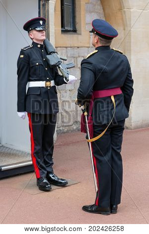 WINDSOR ENGLAND - JUNE 09 2017: Changing guard ceremony with marching soldiers in Windsor Castle country house queen of England