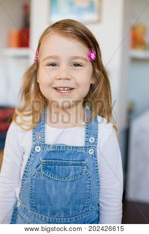 Portrait Of Little Girl With Jeans Dress Looking