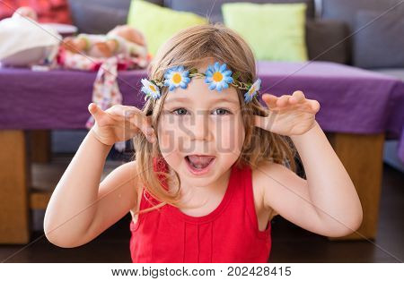 Portrait Of Hippie Little Girl Teasing With Hands