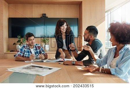 Business Professionals Having A Meeting In Boardroom