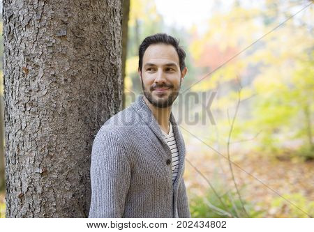 A middle-aged man alone on beautiful autumn day