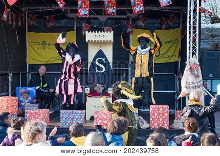 The Hague the Netherlands - 26 November2016: Black piet or zwartepiet celebrating arrival of Dutch Santa Clause Sinterklaas