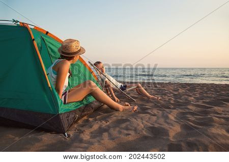 Beach Camping. Kids camping and activity on the beach at sunset