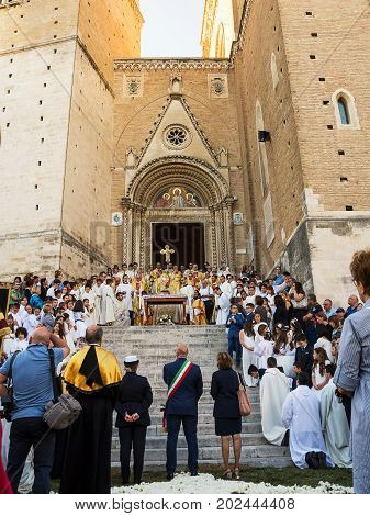 Chieti Italy - 18 June 2017: The bishop give blessing from the stairs of the cathedral of Chieti to Mayor prefect and authority