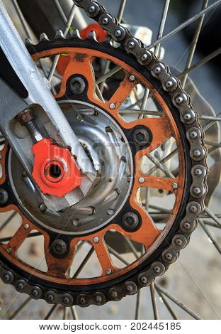 Detailed view on a motorcycle wheel. Vertical position.