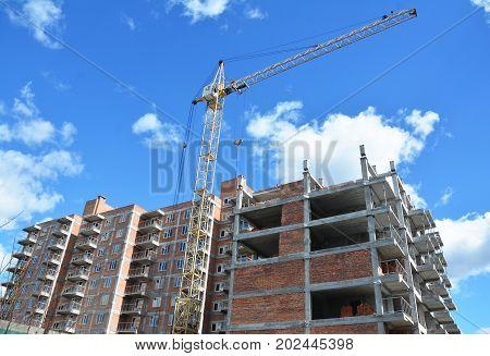 Tower crane on industrial building construction. Crane Construction Site.