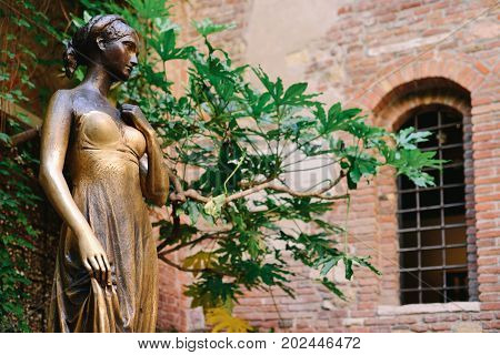 VERONA ITALY - MAY 2017: Patio and statue Juliet Verona Italy. Very popular tourist place.