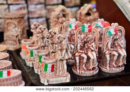 VERONA ITALY - MAY 2017: Souvenir market in Verona. Famous figures Romeo and Juliet a landmark in Italy.