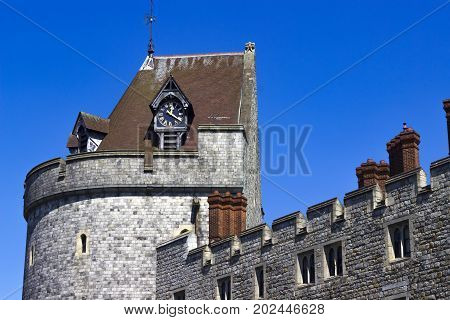 Windsor United Kingdom - 26 May 2017: Clock and clocktower of Windsor Castle on a sunny day.