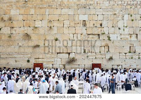 JERUSALEM ISRAEL - APRIL 2017: The Western wall or Wailing wall is the holiest place to Judaism in the old city of Jerusalem Israel.