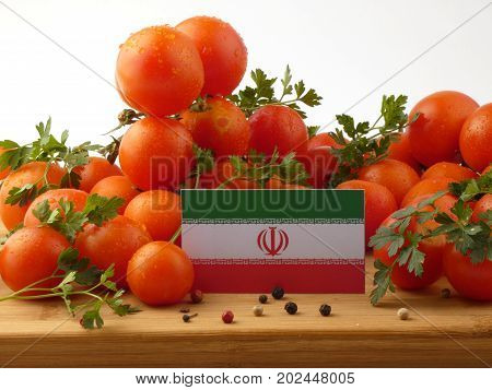 Iranian Flag On A Wooden Panel With Tomatoes Isolated On A White Background