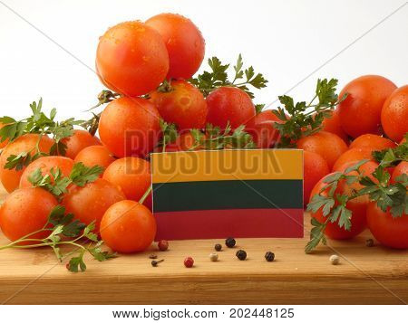 Lithuanian Flag On A Wooden Panel With Tomatoes Isolated On A White Background