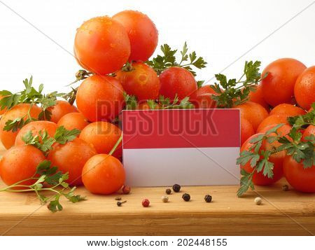 Indonesian Flag On A Wooden Panel With Tomatoes Isolated On A White Background