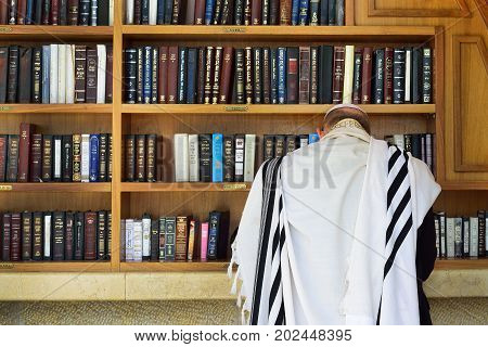 JERUSALEM ISRAEL - APRIL 2017:  Orthodox Jew prays near the book of the Torah.