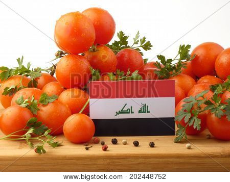 Iraqi Flag On A Wooden Panel With Tomatoes Isolated On A White Background