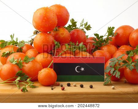 Libyan Flag On A Wooden Panel With Tomatoes Isolated On A White Background