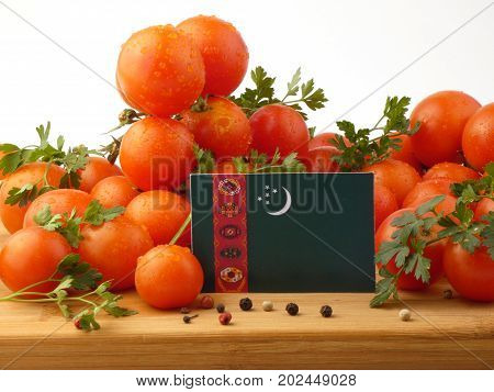 Turkmenistan Flag On A Wooden Panel With Tomatoes Isolated On A White Background