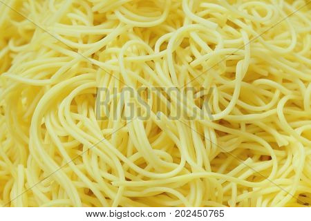 Cuisine and Food Golden Pile of Yellow Egg Noodles for Asian Cooking Background.