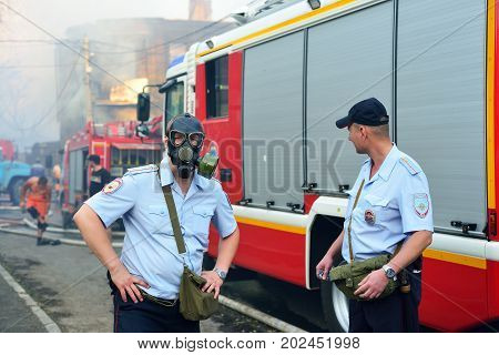 ROSTOV-ON-DON RUSSIA - AUGUST 21 2017: police stand in a cordon of the burning area of the city poisonous smog from fire. Rostov-on-don Russia.