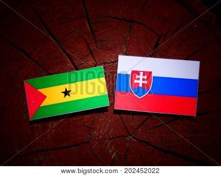 Sao Tome And Principe Flag With Slovakian Flag On A Tree Stump Isolated