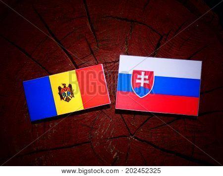 Moldovan Flag With Slovakian Flag On A Tree Stump Isolated