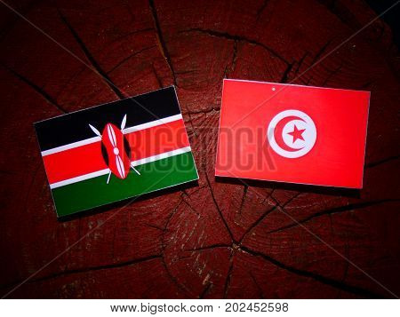 Kenyan Flag With Tunisian Flag On A Tree Stump Isolated