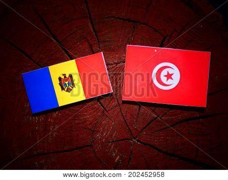 Moldovan Flag With Tunisian Flag On A Tree Stump Isolated